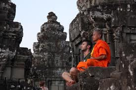 monk teaching westerner to meditate