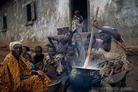 women cooking nshima